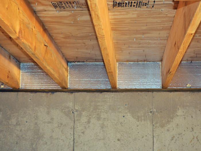Silverglo Insulation Installed In A Floor Joist Uvalde