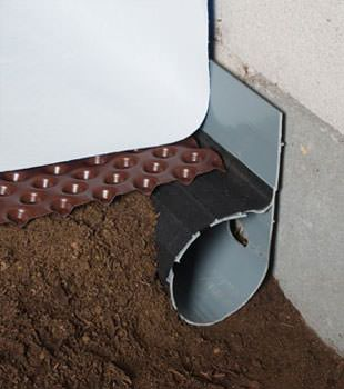 Closeup of a crawl space drainage system installed in Poteet