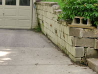 a failing retaining wall around a driveway in San Antonio