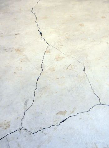 severely cracked, heaving slab floors in a home in Devine