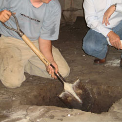 Digging a hole for the engineered fill used in a crawl space support system installation in Del Rio
