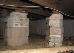 crawl space repairs done with concrete cinder blocks and wood shims in a Lockhart home