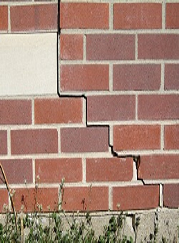 photo of a rotating foundation wall with cracks in Poteet