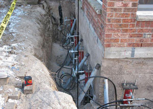 Foundation push piers installed around a house with a foundation settlement issues in Poteet