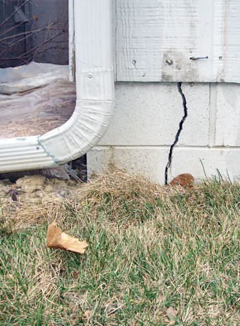 foundation wall cracks due to street creep in Devine