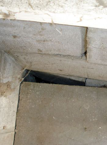 inward rotation of a foundation wall damaged by street creep in a garage in Pearsall
